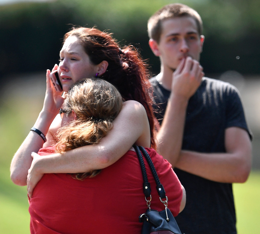 . Kaitlyn Adams, a member of the Burnette Chapel Church of Christ, hugs another church member at the scene after shots were fired at the church on Sunday, Sept. 24, 2017, in Antioch, Tenn. (Andrew Nelles/The Tennessean via AP)