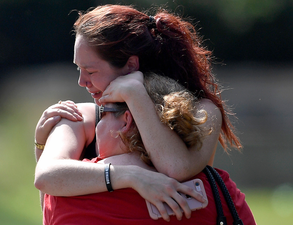 . Kaitlyn Adams, a member of the Burnette Chapel Church of Christ, hugs another church member at the scene after a deadly shooting at the church on Sunday, Sept. 24, 2017, in Antioch, Tenn. (Andrew Nelles/The Tennessean via AP)