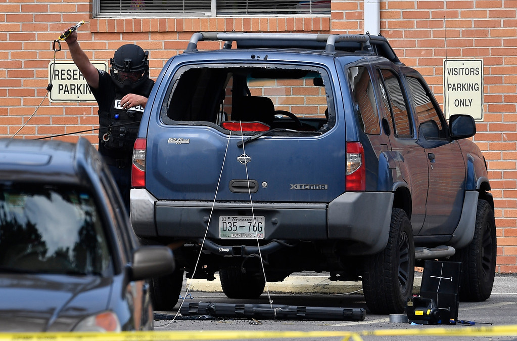 . Police investigate the scene outside the Burnette Chapel Church of Christ after a deadly shooting at the church on Sunday, Sept. 24, 2017, in Antioch, Tenn. (Andrew Nelles/The Tennessean via AP)