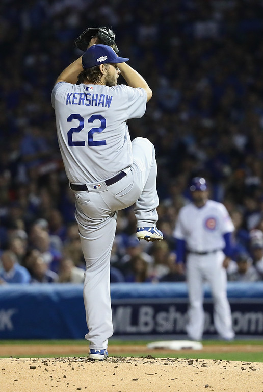 . CHICAGO, IL - OCTOBER 16:  Clayton Kershaw #22 of the Los Angeles Dodgers pitches in the first inning against the Chicago Cubs during game two of the National League Championship Series at Wrigley Field on October 16, 2016 in Chicago, Illinois.  (Photo by Jonathan Daniel/Getty Images)