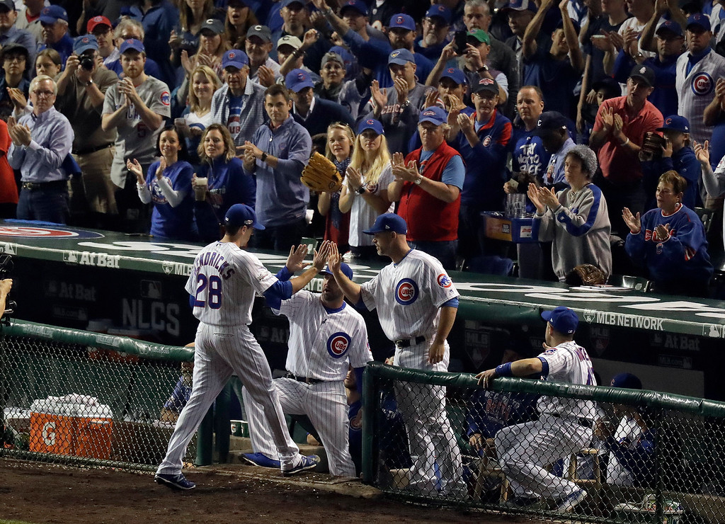 . Chicago Cubs starting pitcher Kyle Hendricks (28) leaves the game during the sixth inning of Game 2 of the National League baseball championship series against the Los Angeles Dodgers, Sunday, Oct. 16, 2016, in Chicago. (AP Photo/Charles Rex Arbogast)