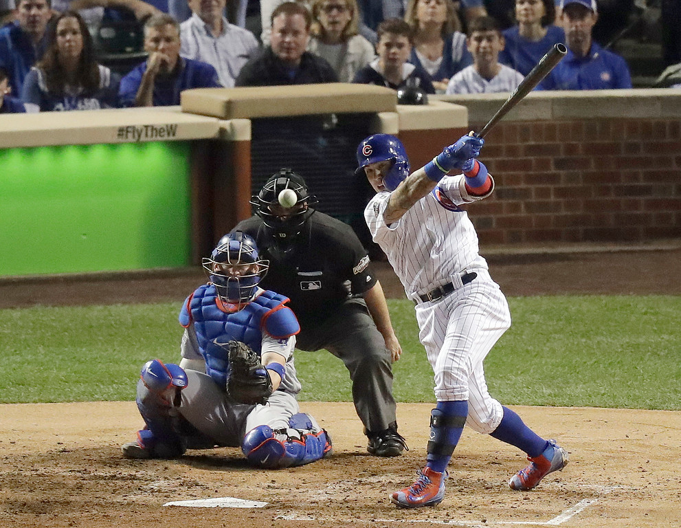 . Chicago Cubs\' Javier Baez (9) hits a single during the fifth inning of Game 2 of the National League baseball championship series against the Los Angeles Dodgers, Sunday, Oct. 16, 2016, in Chicago. (AP Photo/Charles Rex Arbogast)