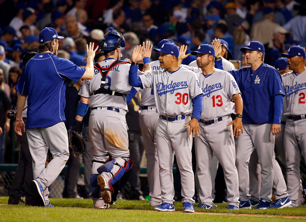. Los Angeles Dodgers players celebrates after Game 2 of the National League baseball championship series against the Chicago Cubs, Sunday, Oct. 16, 2016, in Chicago. The Dodgers won 1-0 to tie 1-1 in the series. (AP Photo/Nam Y. Huh)