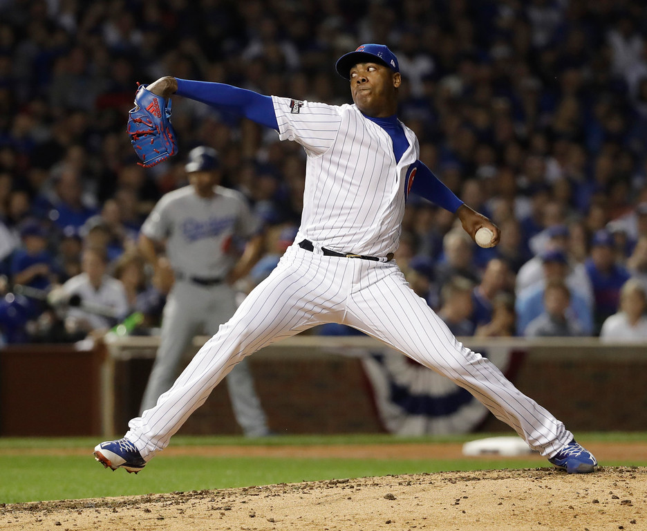 . Chicago Cubs relief pitcher Aroldis Chapman (54) throws during the ninth inning of Game 2 of the National League baseball championship series against the Los Angeles Dodgers, Sunday, Oct. 16, 2016, in Chicago. (AP Photo/David J. Phillip)