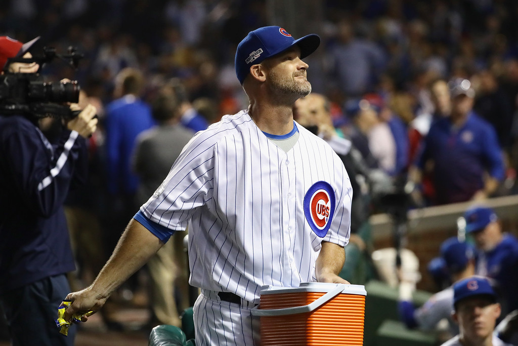 . CHICAGO, IL - OCTOBER 16:  David Ross #3 of the Chicago Cubs throws gum to fans prior to game two of the National League Championship Series between the Chicago Cubs and the Los Angeles Dodgers at Wrigley Field on October 16, 2016 in Chicago, Illinois.  (Photo by Jonathan Daniel/Getty Images)
