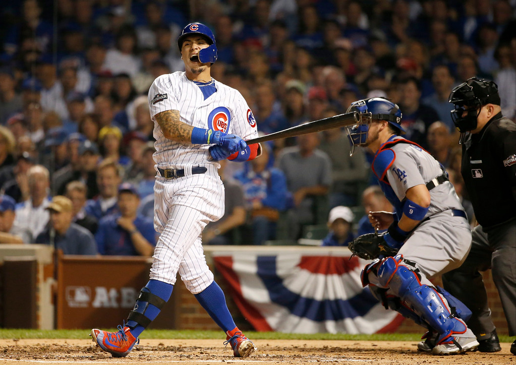 . Chicago Cubs second baseman Javier Baez (9) reacts after striking out during the second inning of Game 2 of the National League baseball championship series against the Los Angeles Dodgers Sunday, Oct. 16, 2016, in Chicago. (AP Photo/Nam Y. Huh)