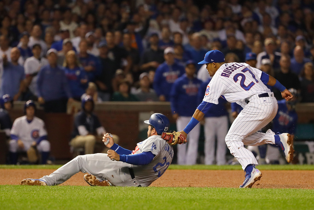 . CHICAGO, IL - OCTOBER 16:  Addison Russell #27 of the Chicago Cubs tags out Adrian Gonzalez #23 of the Los Angeles Dodgers in the sixth inning to complete the double play during game two of the National League Championship Series at Wrigley Field on October 16, 2016 in Chicago, Illinois.  (Photo by Jamie Squire/Getty Images)