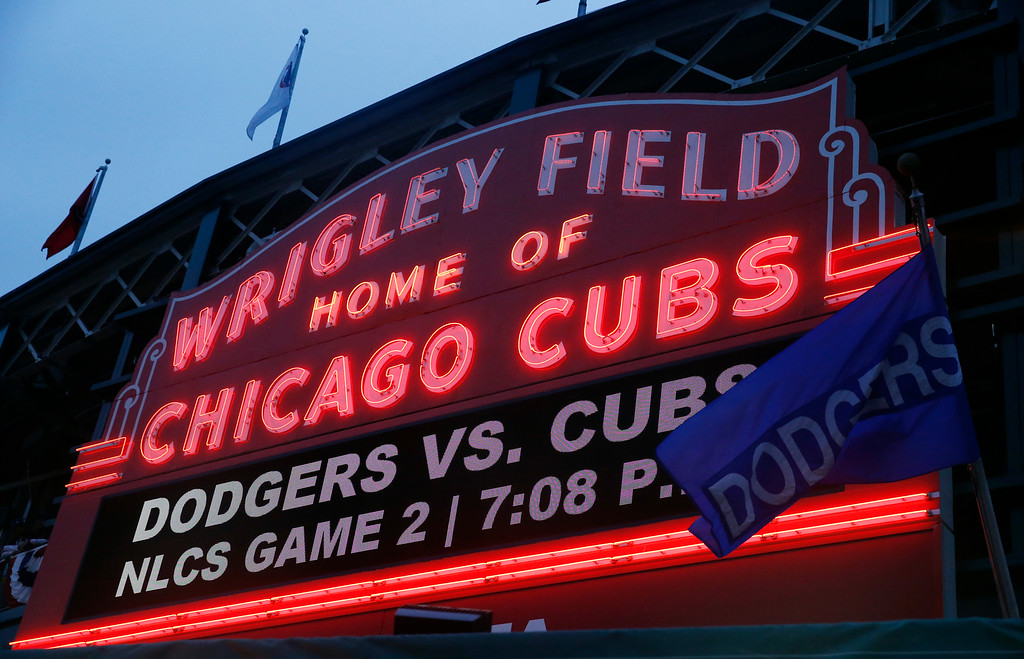 . Wrigley Field marquee is lit before Game 2 of the National League baseball championship series between the Chicago Cubs and the Los Angeles Dodgers, Sunday, Oct. 16, 2016, in Chicago. (AP Photo/Nam Y. Huh)