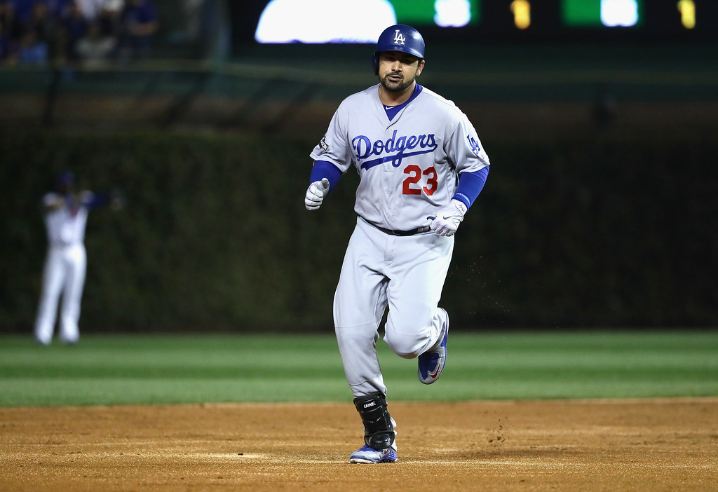 . CHICAGO, IL - OCTOBER 16:  Adrian Gonzalez #23 of the Los Angeles Dodgers runs the bases after hitting a solo home run in the second inning against the Chicago Cubs during game two of the National League Championship Series at Wrigley Field on October 16, 2016 in Chicago, Illinois.  (Photo by Jonathan Daniel/Getty Images)