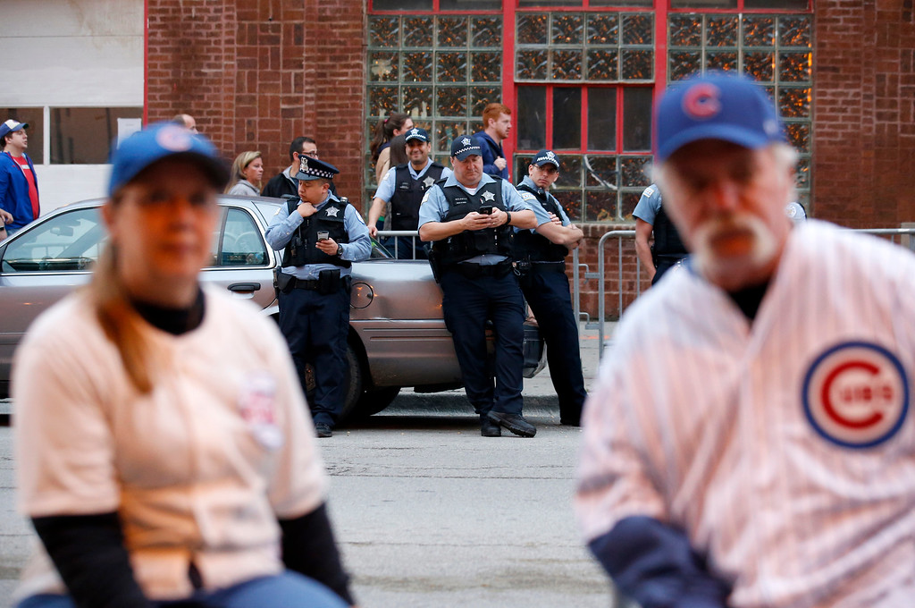 . Chicago police officers guard outside Wrigley Field as fans arrive before Game 2 of the National League baseball championship series between the Chicago Cubs and the Los Angeles Dodgers, Sunday, Oct. 16, 2016, in Chicago. (AP Photo/Nam Y. Huh)