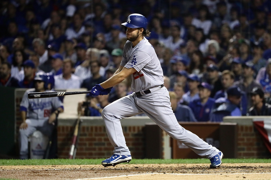 . CHICAGO, IL - OCTOBER 16:  Clayton Kershaw #22 of the Los Angeles Dodgers hits a single in the fifth inning against the Chicago Cubs during game two of the National League Championship Series at Wrigley Field on October 16, 2016 in Chicago, Illinois.  (Photo by Jonathan Daniel/Getty Images)