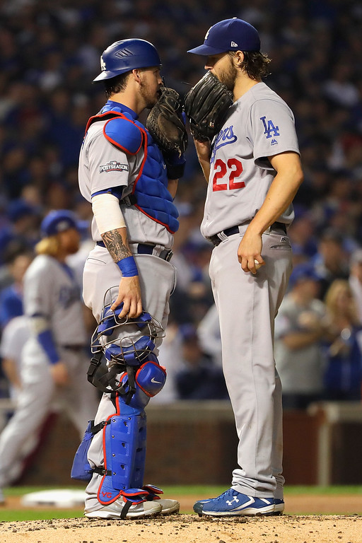 . CHICAGO, IL - OCTOBER 16:  Yasmani Grandal #9 and Clayton Kershaw #22 of the Los Angeles Dodgers meet on the pitcher\'s mound in the fifth inning against the Chicago Cubs during game two of the National League Championship Series at Wrigley Field on October 16, 2016 in Chicago, Illinois.  (Photo by Jamie Squire/Getty Images)
