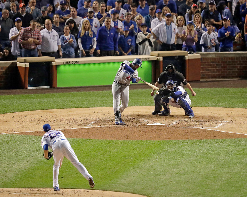 . Los Angeles Dodgers\' Adrian Gonzalez (23) strikes out on a pitch by Chicago Cubs starting pitcher Kyle Hendricks (28) during the third inning of Game 2 of the National League baseball championship series against the Chicago Cubs, Sunday, Oct. 16, 2016, in Chicago. (AP Photo/Charles Rex Arbogast)
