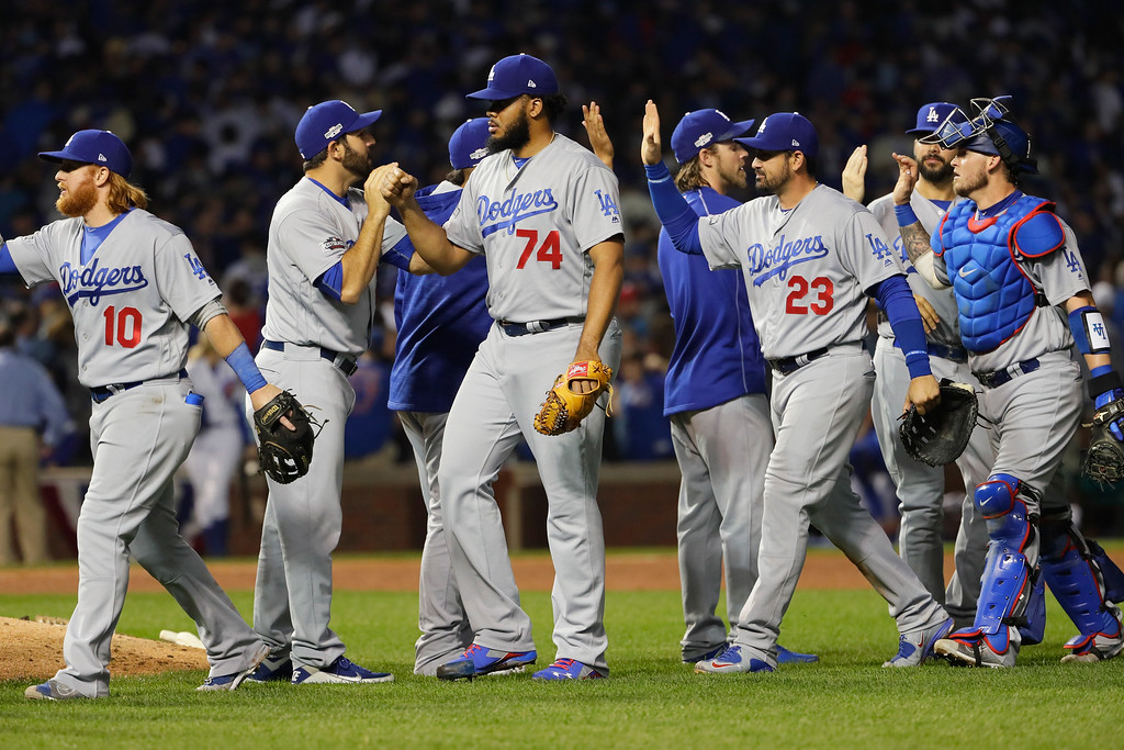 . CHICAGO, IL - OCTOBER 16:  Kenley Jansen #74 and Adrian Gonzalez #23 of the Los Angeles Dodgers celebrate with teammates after defeating the Chicago Cubs 1-0 in game two of the National League Championship Series at Wrigley Field on October 16, 2016 in Chicago, Illinois.  (Photo by Jamie Squire/Getty Images)