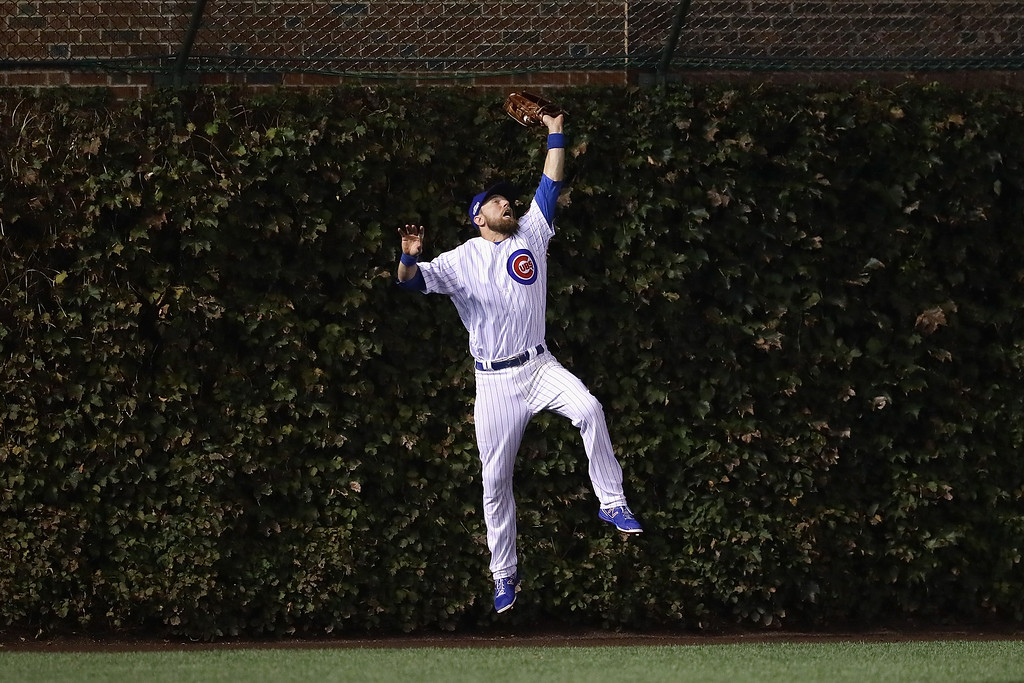 . CHICAGO, IL - OCTOBER 16:  Ben Zobrist #18 of the Chicago Cubs catches a fly ball hit by Joc Pederson #31 of the Los Angeles Dodgers (not pictured) at the wall in the second inning during game two of the National League Championship Series at Wrigley Field on October 16, 2016 in Chicago, Illinois.  (Photo by Jonathan Daniel/Getty Images)