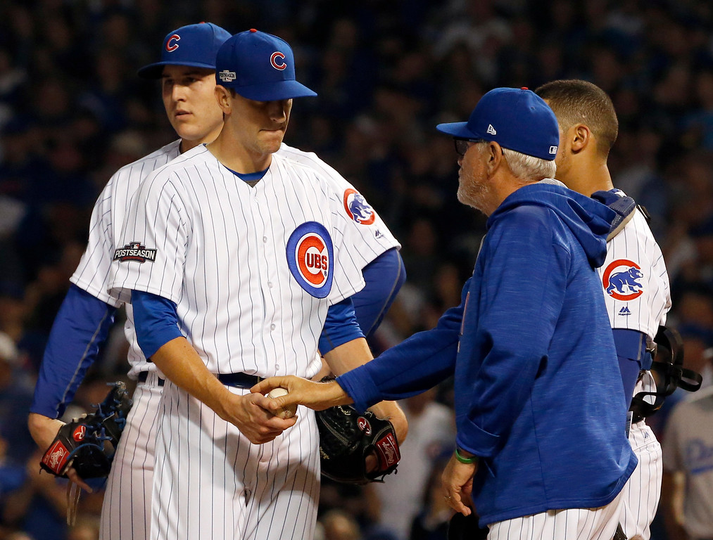 . Chicago Cubs manager Joe Maddon, right, takes the ball from starting pitcher Kyle Hendricks during the sixth inning of Game 2 of the National League baseball championship series against the Los Angeles Dodgers, Sunday, Oct. 16, 2016, in Chicago. (AP Photo/Nam Y. Huh)