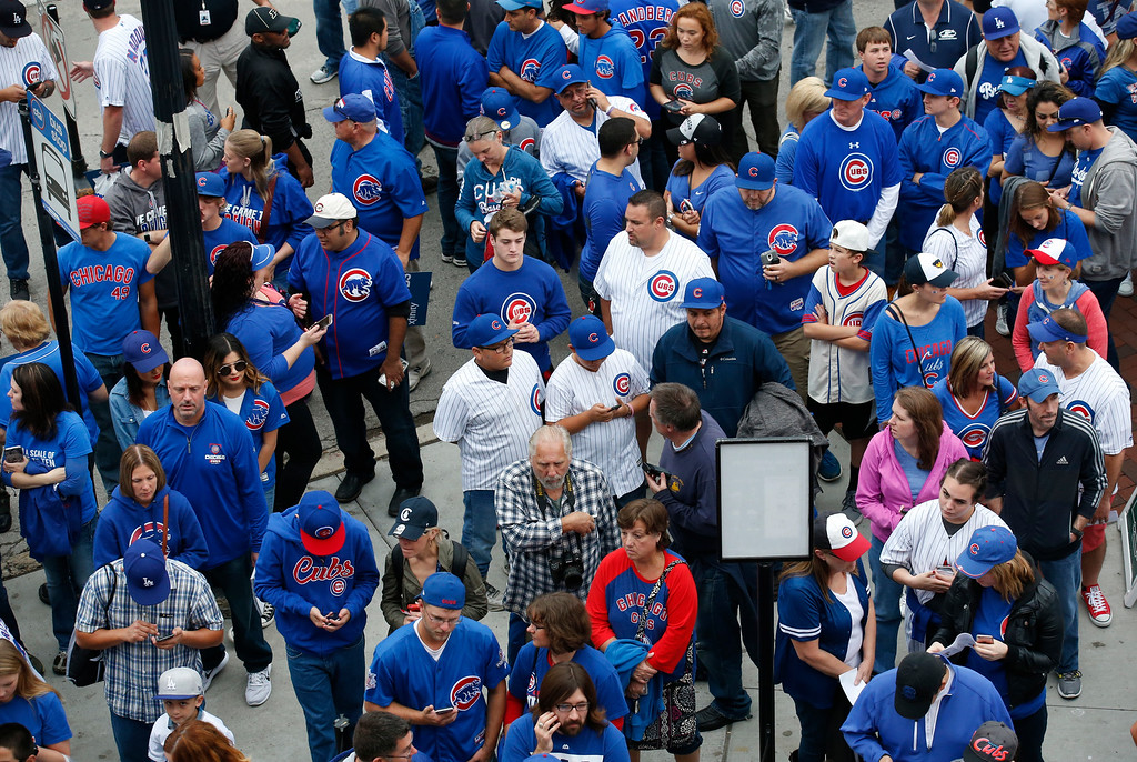 . Fans wait outside Wrigley Field before Game 2 of the National League baseball championship series between the Chicago Cubs and the Los Angeles Dodgers, Sunday, Oct. 16, 2016, in Chicago. (AP Photo/Nam Y. Huh)