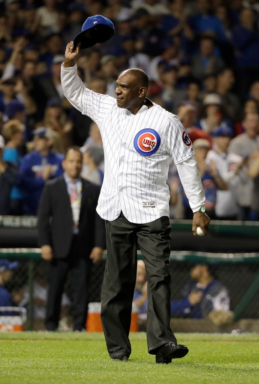 . Former Chicago Cubs player Andre Dawson waves to fans before throwing a ceremonial first pitch before Game 2 of the National League baseball championship series between the Chicago Cubs and the Los Angeles Dodgers, Sunday, Oct. 16, 2016, in Chicago. (AP Photo/David J. Phillip)
