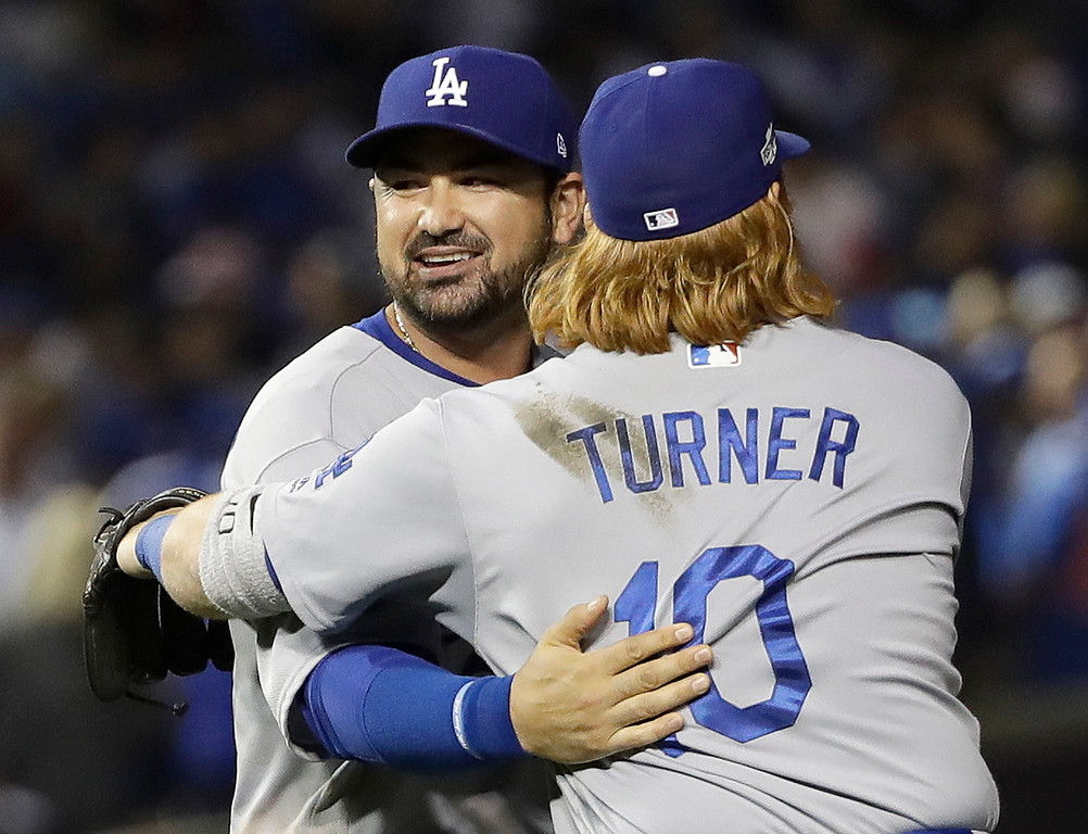 . Los Angeles Dodgers\' Adrian Gonzalez, left, celebrates with Justin Turner after Game 2 of the National League baseball championship series against the Chicago Cubs, Sunday, Oct. 16, 2016, in Chicago. The Dodgers won 1-0 to tie 1-1 in the series. (AP Photo/David J. Phillip)