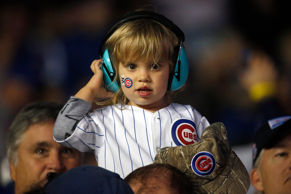 . A young Chicago Cubs fan watches during the fourth inning of Game 2 of the National League baseball championship series between the Chicago Cubs and the Los Angeles Dodgers, Sunday, Oct. 16, 2016, in Chicago. (AP Photo/Nam Y. Huh)