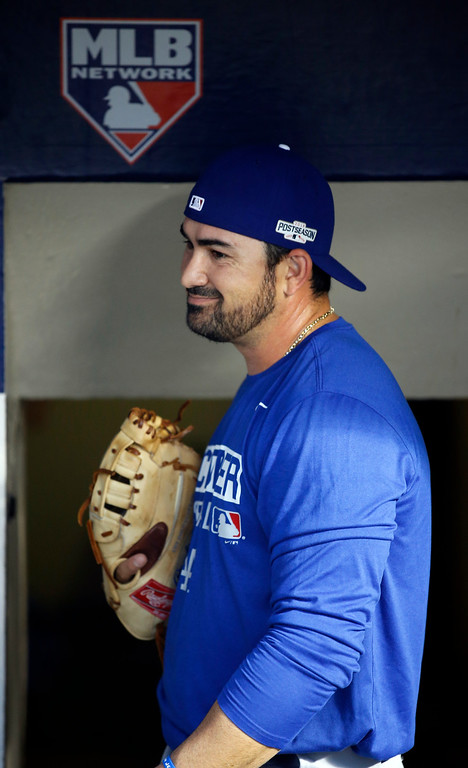 . Los Angeles Dodgers\' Adrian Gonzalez gets ready to warm up before Game 2 of the National League baseball championship series against the Chicago Cubs, Sunday, Oct. 16, 2016, in Chicago. (AP Photo/Nam Y. Huh)