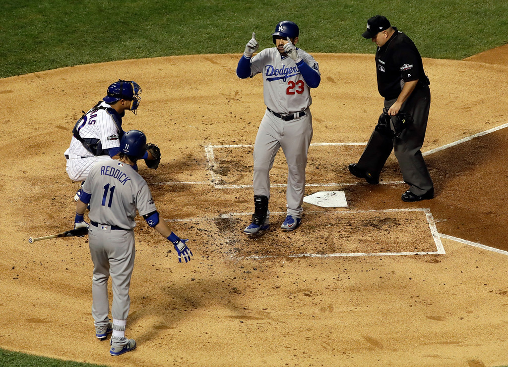 . Los Angeles Dodgers\' Adrian Gonzalez (23) celebrates after hitting a home run during the second inning of Game 2 of the National League baseball championship series against the Chicago Cubs, Sunday, Oct. 16, 2016, in Chicago. (AP Photo/David J. Phillip)