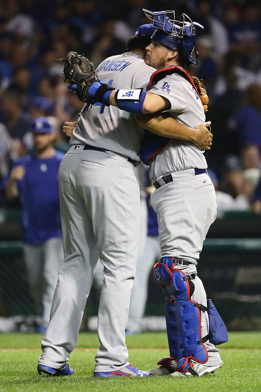 . CHICAGO, IL - OCTOBER 16:  Kenley Jansen #74 of the Los Angeles Dodgers celebrates with Yasmani Grandal #9 after defeating the Chicago Cubs 1-0 in game two of the National League Championship Series at Wrigley Field on October 16, 2016 in Chicago, Illinois.  (Photo by Jonathan Daniel/Getty Images)