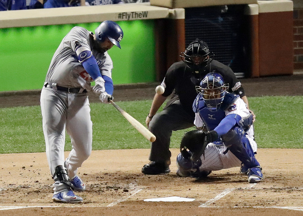 . Los Angeles Dodgers\' Adrian Gonzalez (23) hits a home run during the second inning of Game 2 of the National League baseball championship series against the Chicago Cubs, Sunday, Oct. 16, 2016, in Chicago. (AP Photo/Charles Rex Arbogast)
