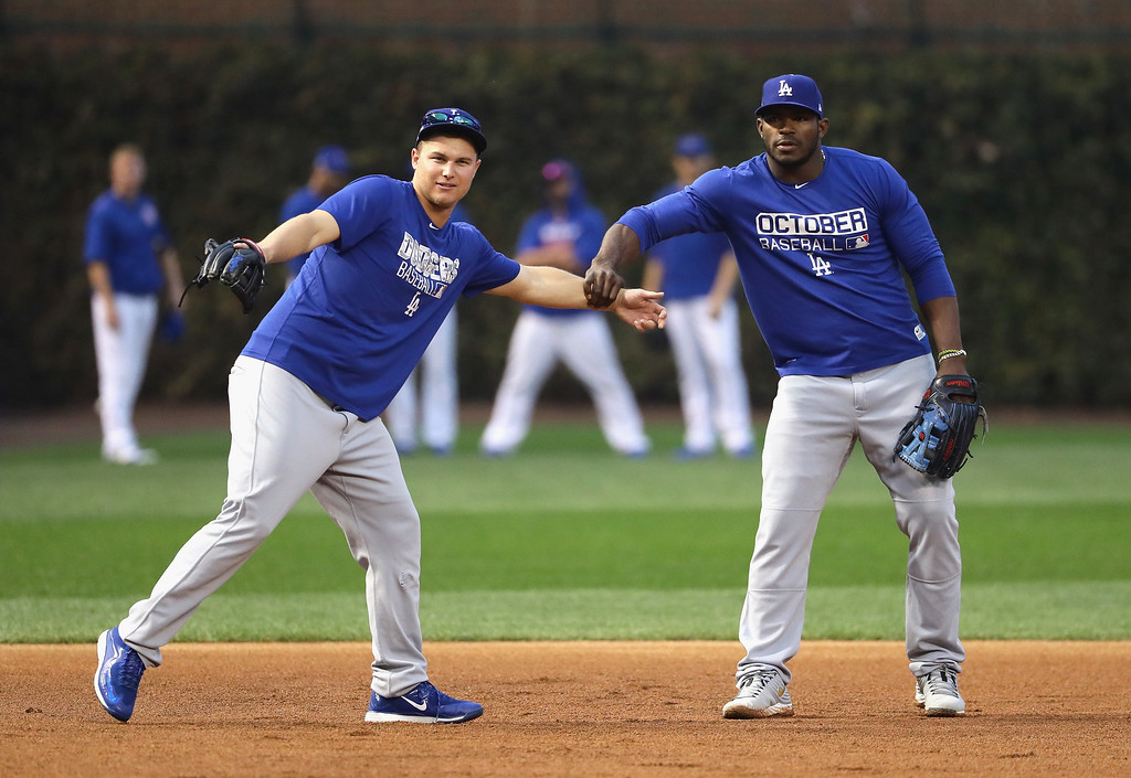 . CHICAGO, IL - OCTOBER 16:  Joc Pederson #31 and Yasiel Puig #66 of the Los Angeles Dodgers joke around prior to game two of the National League Championship Series against the Chicago Cubs at Wrigley Field on October 16, 2016 in Chicago, Illinois.  (Photo by Jonathan Daniel/Getty Images)