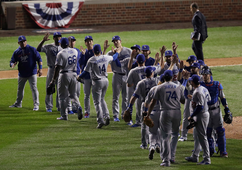 . Los Angeles Dodgers players celebrates after Game 2 of the National League baseball championship series against the Chicago Cubs, Sunday, Oct. 16, 2016, in Chicago. The Dodgers won 1-0 to tie 1-1 in the series. (AP Photo/Charles Rex Arbogast)