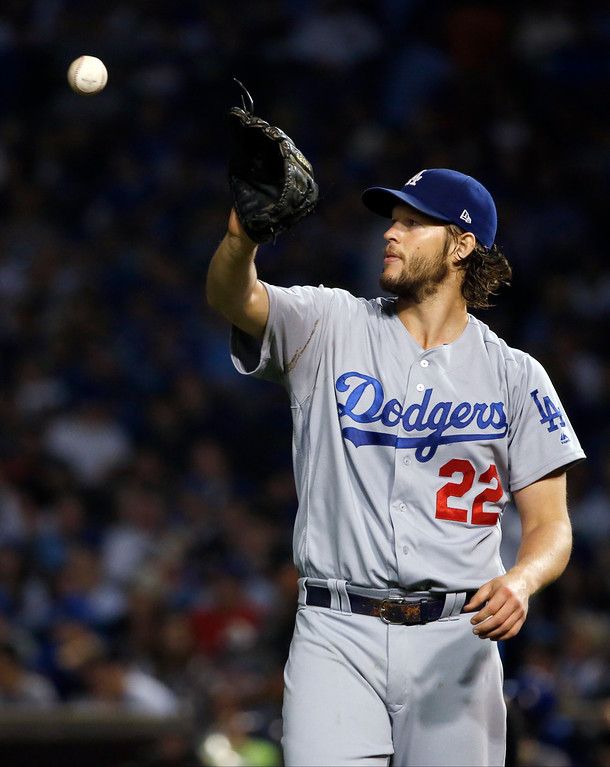 . Los Angeles Dodgers starting pitcher Clayton Kershaw (22) gets a ball during the fourth inning of Game 2 of the National League baseball championship series against the Chicago Cubs, Sunday, Oct. 16, 2016, in Chicago. (AP Photo/Nam Y. Huh)