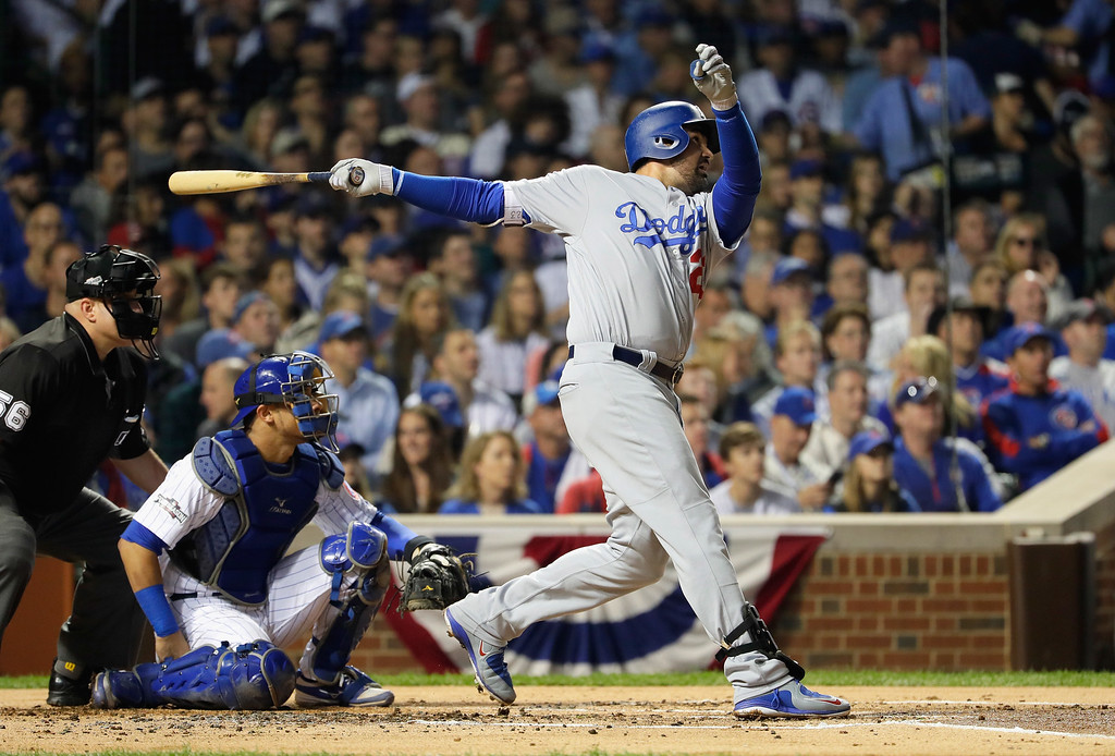 . CHICAGO, IL - OCTOBER 16:  Adrian Gonzalez #23 of the Los Angeles Dodgers hits a solo home run in the second inning against the Chicago Cubs during game two of the National League Championship Series at Wrigley Field on October 16, 2016 in Chicago, Illinois.  (Photo by Jamie Squire/Getty Images)