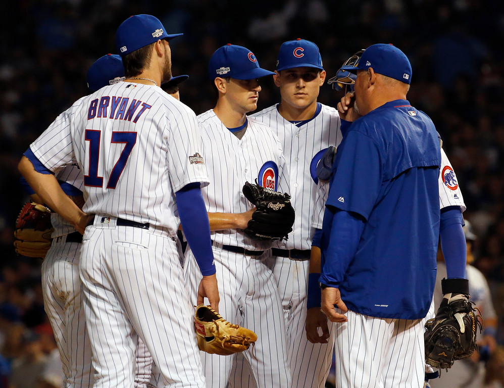 . Chicago Cubs pitching coach Chris Bosio, right, talks to starting pitcher Kyle Hendricks during the third inning of Game 2 of the National League baseball championship series against the Los Angeles Dodgers, Sunday, Oct. 16, 2016, in Chicago. (AP Photo/Nam Y. Huh)