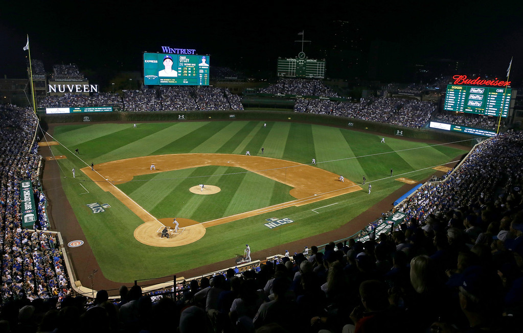 . Chicago Cubs starting pitcher Kyle Hendricks (28) throws during the first inning of Game 2 of the National League baseball championship series against the Los Angeles Dodgers, Sunday, Oct. 16, 2016, in Chicago. (AP Photo/Kiichiro Sato)