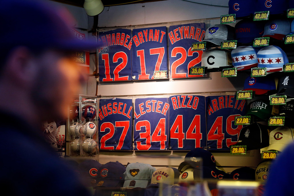 . Chicago Cubs merchandise are displayed outside Wrigley Field as fans arrive before Game 2 of the National League baseball championship series between the Chicago Cubs and the Los Angeles Dodgers, Sunday, Oct. 16, 2016, in Chicago. (AP Photo/Nam Y. Huh)