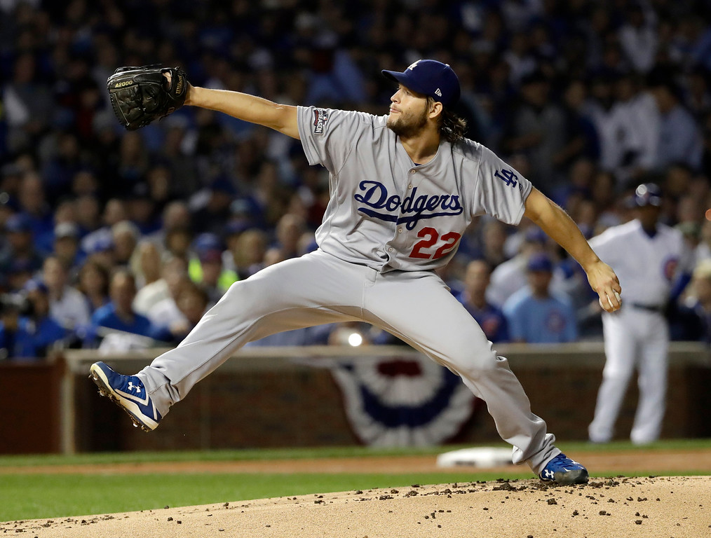 . Los Angeles Dodgers starting pitcher Clayton Kershaw (22) throws during the first inning of Game 2 of the National League baseball championship series against the Chicago Cubs, Sunday, Oct. 16, 2016, in Chicago. (AP Photo/David J. Phillip)