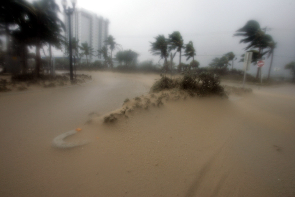 . Sand is blown off the beach at Fort Lauderdale, Fla. late Thursday, Aug. 25, 2005 as Hurricane Katrina came ashore. (AP Photo/J. Pat Carter)