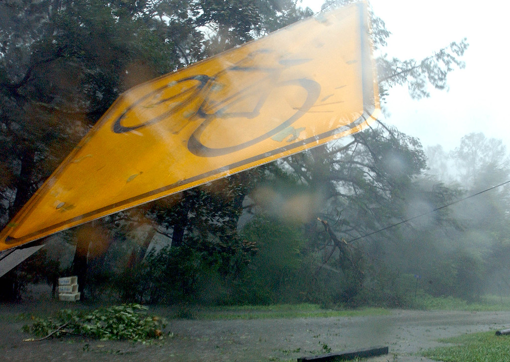 . A street sign blows in the winds of Hurricane Katrina on Monday Aug. 29, 2005 in Lacombe, La. as the eye of the storm nears tearing down trees onto power lines. (AP Photo/Mari Darr~Welch)
