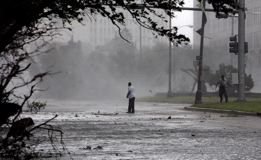 . Tyrell Willis fights his way through strong winds as he tries to make his way to the Louisiana Superdome in New Orleans as Hurricane Katrina batters the Crescent City on Monday, Aug. 29, 2005. Willis\'s home was damaged by the storm, forcing him to walk to the Superdome where officials provided shelter from the hurricane.  (AP Photo/Bill Haber)