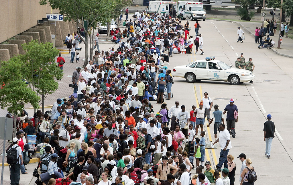 . Residents wait in line to enter the Superdome which is being used as an emergency shelter before the arrival of Hurricane Katrina August 28, 2005 in New Orleans, Louisiana.   (Photo by Mario Tama/Getty Images)
