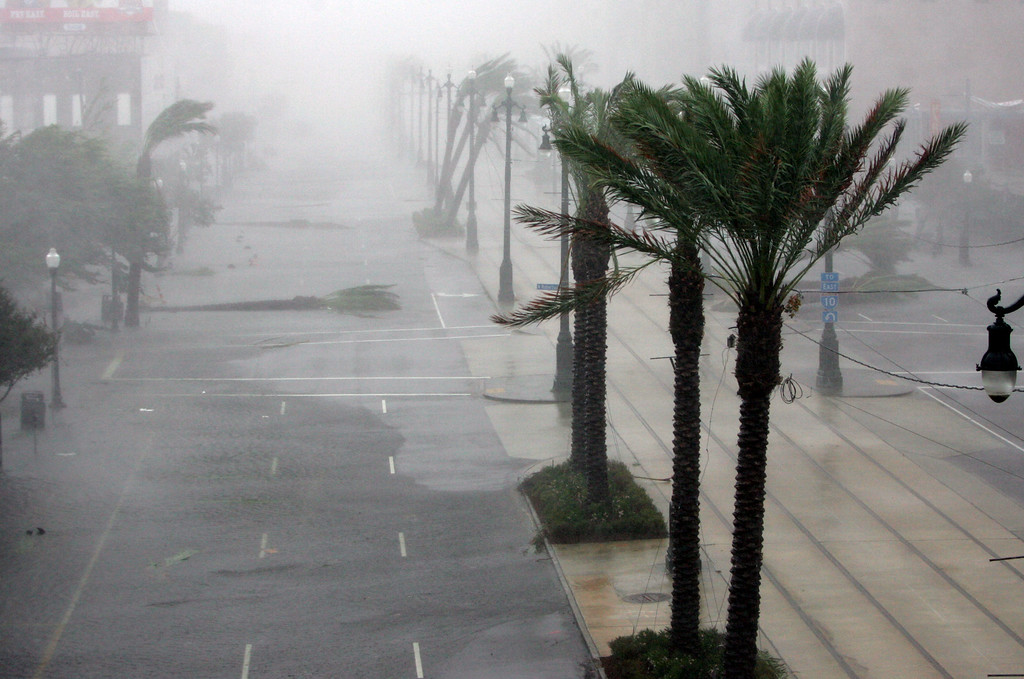 . Canal Street in New Orleans is empty except for the debris of thrown trees as Hurricane Katrina pounds the Crescent City on Monday, Aug. 29, 2005.  (AP Photo/Dave Martin)