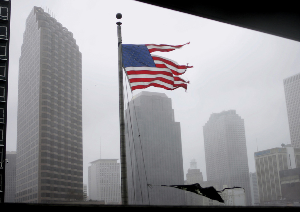 . Hurricane winds shred an American flag in downtown New Orleans, Louisiana as Hurricane Katrina passes over the Crescent City on Monday, Aug. 29, 2005.  (AP Photo/Bill Haber)