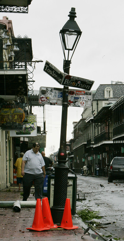 . A New Orleans resident begins the process of cleaning up Bourbon Street in the French Quarter of New Orleans on Monday, Aug. 29, 2005. Hurricane Katrina pounded the city with 140 mph winds after it made landfall. (AP Photo/Bill Haber)
