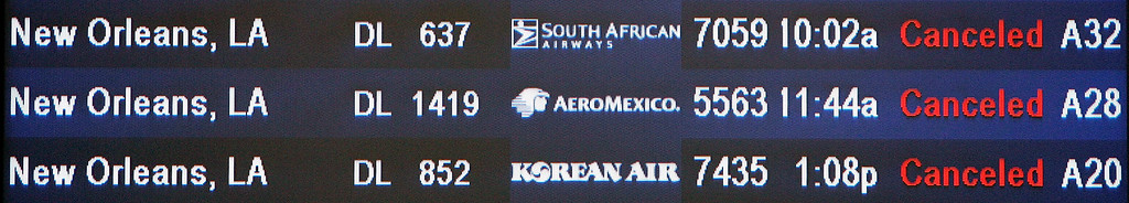 . File - A flight status board annouces the cancellation of flights to New Orleans at Hartsfield Jackson Atlanta International Airport in Atlanta, Monday, Aug. 29, 2005. Many flights to southern destinations in the path of Katrina at the airport were canceled. (AP Photo/Ric Feld)