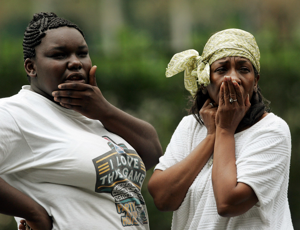 . Linda Lewis, right and her daughter Jyvonne react as they look towards the Hyatt Hotel in New Orleans where their room was blown out when Hurricane Katrina brought 140mph winds to the Crescent City on Monday, Aug. 29, 2005. (AP Photo/Dave Martin)