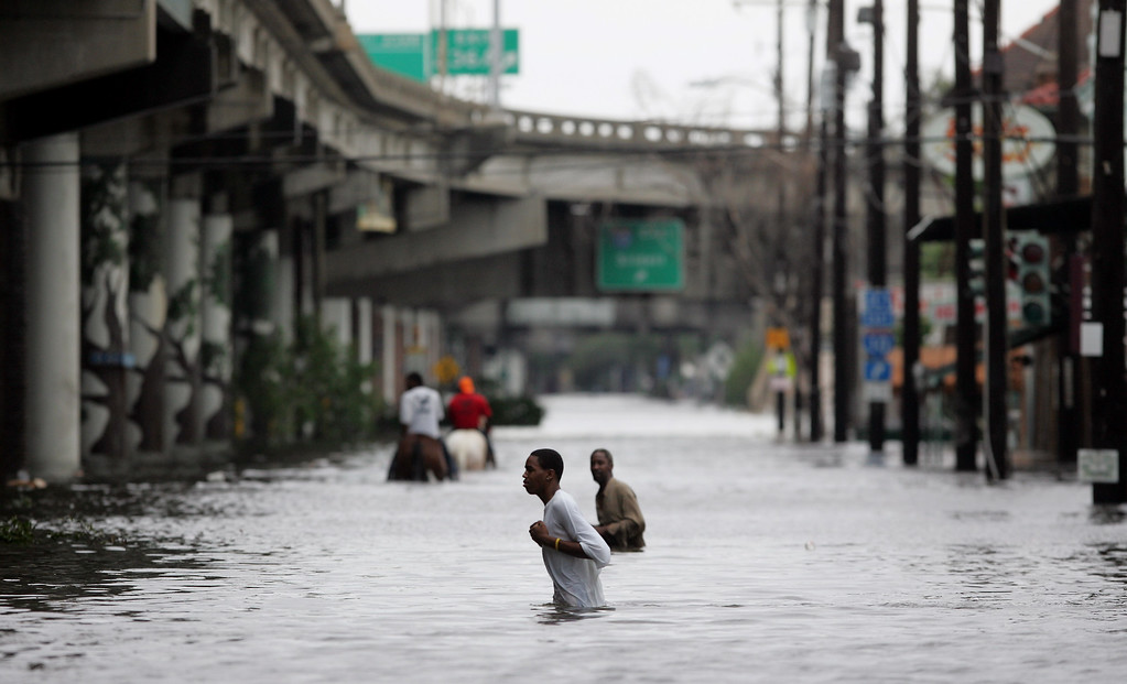 . New Orleans residents walk through chest deep floodwater after Hurricane Katrina made landfall on the Louisiana coast on Monday, Aug. 29, 2005. (AP Photo/Dave Martin)