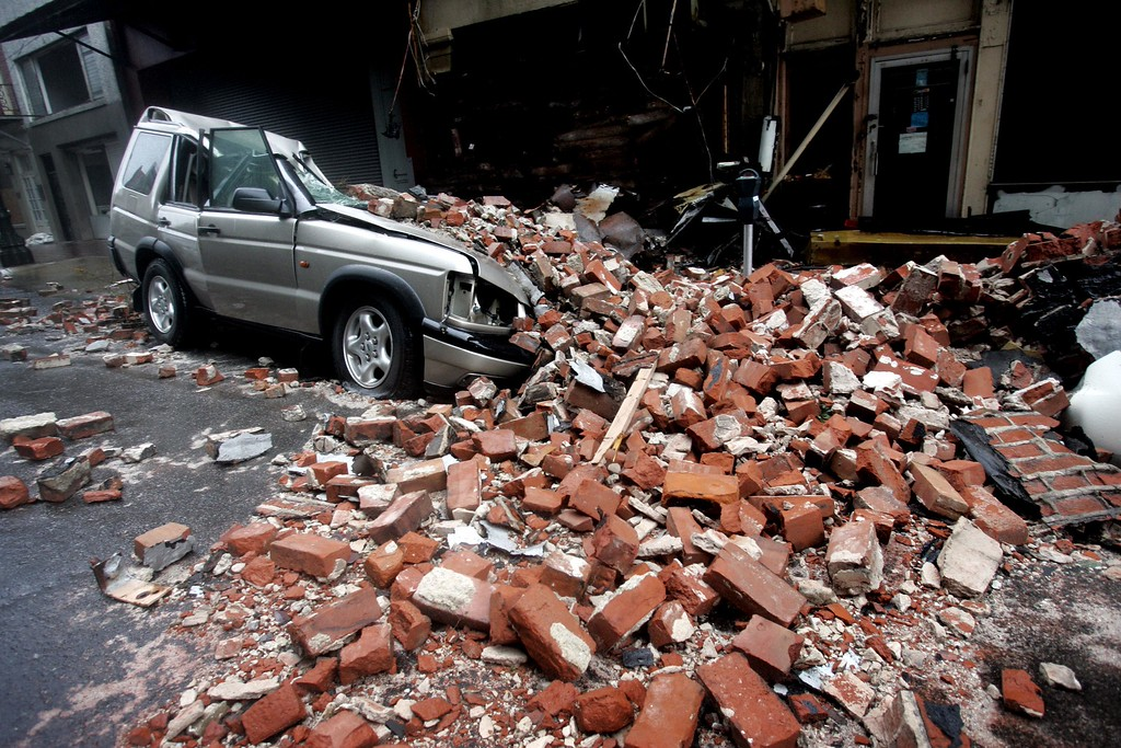 . An SUV is seen crushed by bricks after  Hurricane Katrina hit New Orleans,  Monday Morning, Aug. 29,  2005.  Katrina plowed into the Gulf Coast at daybreak Monday with shrieking, 145-mph winds and blinding rain, submerging entire neighborhoods up to the rooflines in New Orleans, hurling boats onto land and sending water pouring into Mississippi\'s strip of beachfront casinos.    (AP Photo/Eric Gay)