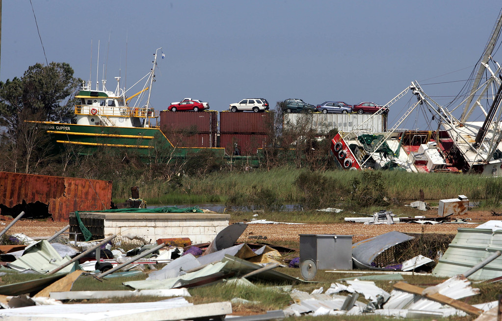 . A cargo ship that was blown onto land by Hurricane Katrina is shown, Tuesday Aug. 30, 2005, in Bayou La Batre, Ala. (AP Photo/Rob Carr)