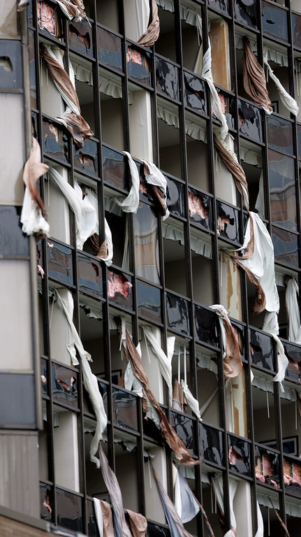 . The North side of the Hyatt hotel in New Orleans was shredded by 140mph winds when Hurricane Katrina made landfall on the Louisiana coast on Monday, Aug. 29, 2005.   (AP Photo/Dave Martin)