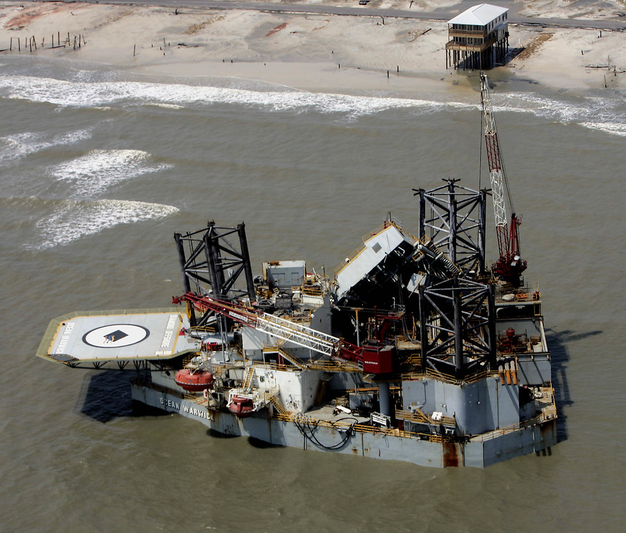 . An oil platform ripped from its mooring in the Gulf of Mexico rests by the shore in Dauphin Island, Ala. Tuesday Aug. 30, 2005 after Hurricane Katrina passed through the area.  The potential damage to oil platforms, refineries and pipelines that remain closed along the Gulf Coast drove energy prices to new highs Tuesday, with crude futures briefly topping $70 a barrel and wholesale gasoline costs surging to levels that could lead to $3 a gallon at the pump in some markets. (AP Photo/Peter Cosgrove)